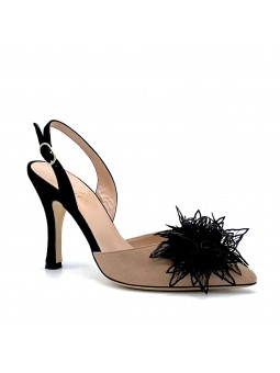 Antique pink and black suede slingback with a black  flower   accessory. Leathe