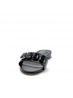 Black leather mule with bezels. Leather lining, leather sole. 1 cm heel.